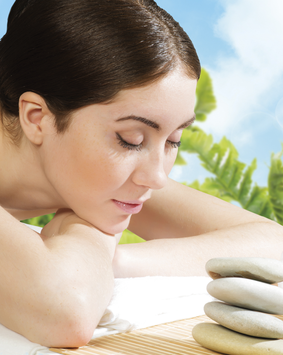 Woman relaxing with spa background